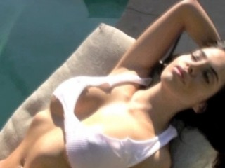 Francesca is back in this hot video wearing a sheer white top and panties Watch as she lays out by the pool working on her tan in a skimpy little outfit