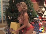 Janice posing by the christmas tree